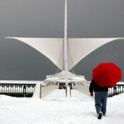 Man with red umbrella at the Calatrava