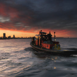 Tugboat at sunset