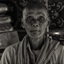 Man in a Buddhist temple near Kep, Cambodia