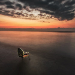 Sunrise with abandoned chair