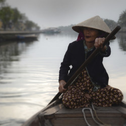 Shared Memory-Boat Woman on Thu Bon River, Vietnam