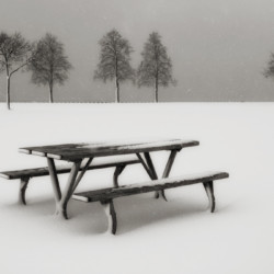 Picnic table in winter in black and white