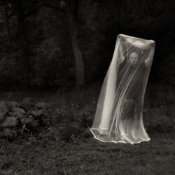 Man with portable mosquito net