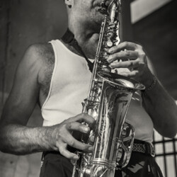 Al busking with his saxaphone