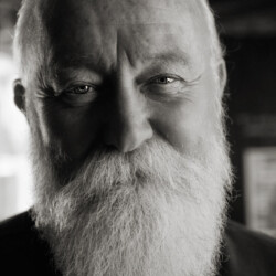 Man with a white beard and eyes that twinkled