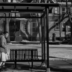 Woman at the bus stop